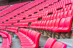 Seats on stadium steps bleacher with spot light pole Royalty Free Stock Photos