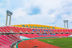 Seats on stadium steps bleacher with spot light pole Stock Image