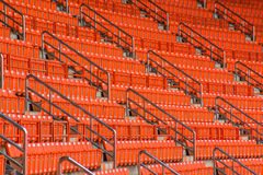 Seats on stadium steps bleacher with spot light pole Royalty Free Stock Image