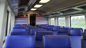 Inside high speed train. Seats in a suburban train in the European region. Passenger empty wagon with Blue Seats. Inside high speed train. Empty train with seats stock video footage