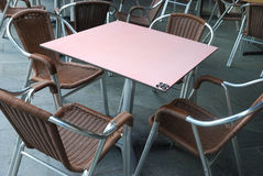 Seats and a table at a dinning area in public. Stock Images