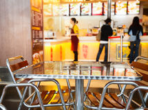 Seats and table at a fast food cafe Royalty Free Stock Photos