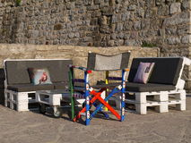 Seats And Table Made Out Of Pallets In stone  wall Royalty Free Stock Photography