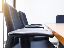 Seats and table in meeting room Stock Image