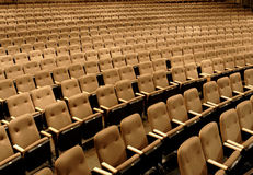 Seats in a theater. Empty seats in a performing arts theater royalty free stock photo