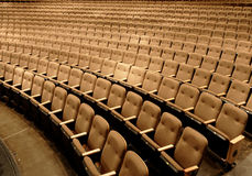 Seats in a theater. Empty seats in a performing arts theater royalty free stock images