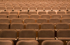 Seats in a theater. Brown seats in a theater, background Royalty Free Stock Photo