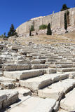Seats in theatre of Dionysus and Acropolis Royalty Free Stock Photo