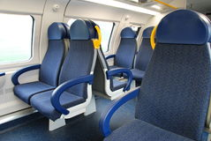 Seats in train. Groups of blues seats in modern train Stock Image