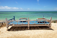 Seats on a tropical beach. A place to relax and eat on the Gili Islands in Indonesia Royalty Free Stock Photo