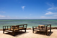 Seats on a tropical beach. A place to relax and eat on the Gili Islands in Indonesia Stock Photos