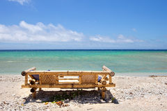 Seats on a tropical beach. A place to relax and eat on the Gili Islands in Indonesia Stock Image