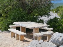 Seats under a tree on Kamenjak mountain Royalty Free Stock Images
