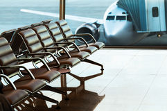 Seats, view from airport hall. Royalty Free Stock Images