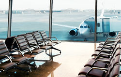 Seats, view from airport hall Royalty Free Stock Photography