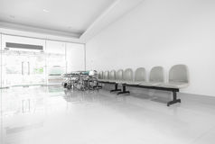 Seats and wheelchair in hospital hallway.  Stock Photography