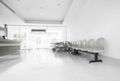 Seats and wheelchair in hospital hallway.  royalty free stock images
