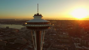 Seattle Aerial. V49 Flying low besides and around Space Needle with cityscape views at sunrise