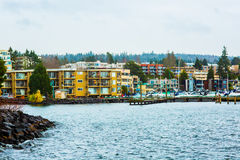 Free Seattle Beach Dock Puget Sound Washington State Harbor Boat Yellow Apartment Blue Water Rocks Trees Evergreen Beautiful Bay Landsc Stock Photo - 95991620