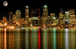 Seattle Business District At Night with Full Moon. This photo is of Seattle Washington's business district at night with a full moon and gorgeous cityscape Royalty Free Stock Image