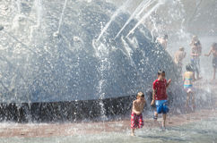 Seattle Center International Fountain. Children enjoy frolicking in the cool waters of the International Fountain that was originally built for the Seattle World Stock Photos