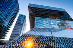 Seattle Central Library. View of the award-winning geometric glass and steel design of the Seattle Central Library from 5th Avenue as the sun sets Royalty Free Stock Images