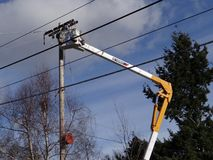 Seattle City Light workmen replace an aging utility pole Royalty Free Stock Photo