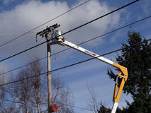 Seattle City Light workmen replace an aging utility pole Stock Photo