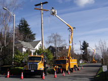 Seattle City Light workmen replace an aging utility pole Stock Image