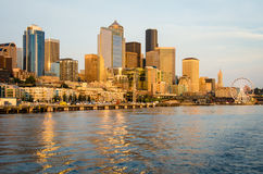 Seattle City Skyline. The Seattle skyline is bathed in golden hues at sunset Stock Photo
