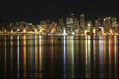 Seattle city skyline at night with lights reflecting in water royalty free stock photo