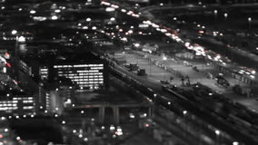 Seattle City Traffic Time Lapse Night Pan Tilt Shift. V18. Panning tIme lapse shot of Seattle city traffic at night using a tilt shift lens with a horizontal stock video