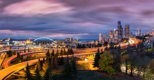 Seattle cityscape at dusk under a dramatic sky Stock Image