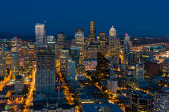 Seattle Cityscape. After sunset with city lights and blue sky. Mt. Rainier in the background Stock Images