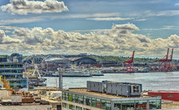 Seattle Waterfront and Harbor with Ferry Terminal and Great. Seattle Great Wheel and Ferry Terminal Sparkle in Spring Sunshine from Rooftop Patio Royalty Free Stock Image