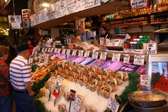 Seattle - the Counter at Pike Place Fish Market. A look at shoppers browsing the offerings at world famous Pike Place Fish Market in downtown Seattle, Washington Stock Photos