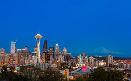 Seattle downtown skyline and Mt. Rainier at night. WA Stock Images