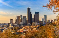 Seattle downtown at sunset in the fall with yellow foliage in the foreground view from Dr. Jose Rizal Park. Seattle downtown skyline at sunset in the fall with royalty free stock images