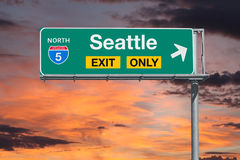 Seattle Exit Only Freeway Sign with Sunrise Sky Stock Photo