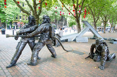 Seattle Fallen Firefighters' Memorial. The four bronze statutes are a memorial inspired by the four firefighters that died while fighting a warehouse fire in Royalty Free Stock Image