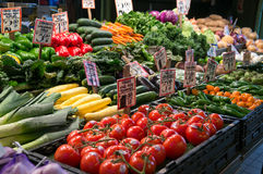 Seattle Farmer`s Market. A vegetable stand located inside Pike`s Market in Seattle, Washington.  There are multiple fresh fruit and vegetable stands at this Royalty Free Stock Photos