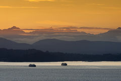 Seattle Ferries at Sunset Royalty Free Stock Photography