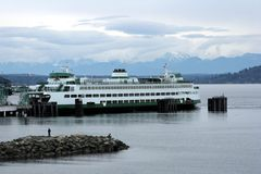 Seattle Ferry. A ferry boat docked with beautiful mountain scenery royalty free stock images