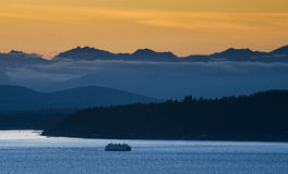 Seattle Ferry and the Olympic Mountains Royalty Free Stock Photography