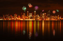 Seattle fireworks. Fireworks over Seattle skyline from Alki park on 4th of July celebration Royalty Free Stock Photos