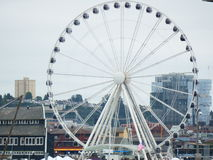 Seattle Great Wheel. A beautiful picture of the Seattle Great Wheel Ferris Wheel with buildings next to it Stock Photo