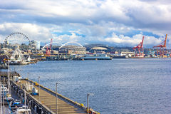Seattle Great Wheel and port cranes under blue cloudy sky in Seattle downtown. Stock Photography