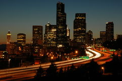 Seattle I-5 At Night. Night time shot of I-5 with moving cars and Seattle, Washington (USA) skyline.  Long exposure with motion blur Royalty Free Stock Photos