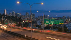 Seattle I-5 Traffic Time Lapse Dusk Pan. V25. Panning clip of Seattle I-5 traffic time lapse with cityscape in background stock video