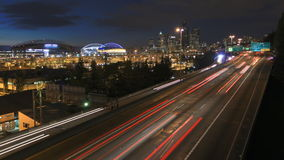 Seattle I-5 Traffic Time Lapse Dusk. V27. Seattle I-5 traffic time lapse with cityscape in background at dusk stock footage